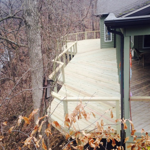 Treated wood deck with cable railing