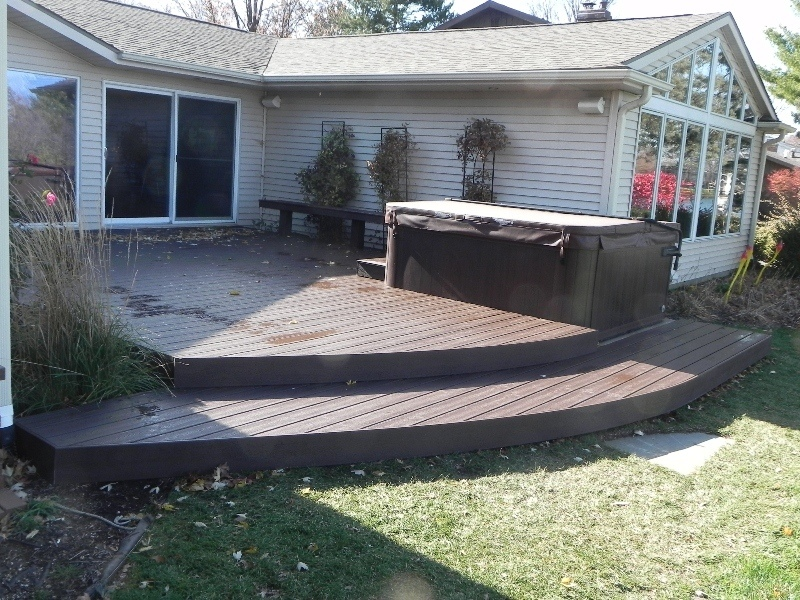 ground deck with steps to backyard