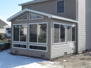 enclosed sunroom with glass around room